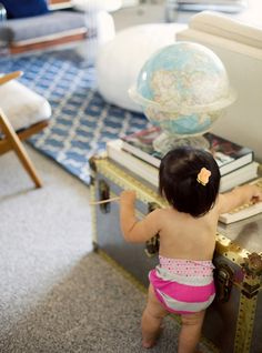 Oh Joy and Emily Henderson baby proof a stylish living room. Cute shot of baby in Honest Co. diapers!
