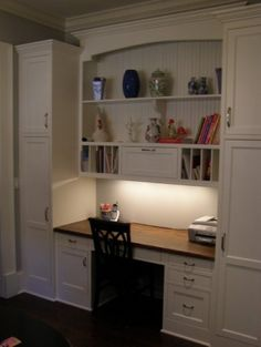oh I love this kitchen desk..... i love the side cabinets, and the curved top