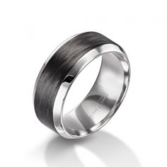 ($2680) Furrer Jacot carbon fiber mens wedding band, from Diamonds Direct. The mix of metal and carbon fiber on this domed men's band is a great modern twist on a simple design. This band is 9 millimeters in width. #furrerjacot #mens #band #weddingband #weddingring #mensring #carbonfiber #black