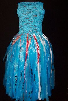 """Blue plastic bags might be perfect for the shiny reflectives on the back. Crochet a little for design andthe rest with """"paper mached"""" strips..."""