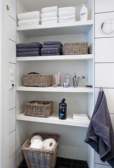 doesn't need to be covered if carefully appointed... baskets do a lot... add paint or texture to back wall and use wood for shelves...                                                                                                                                                                                 More
