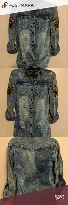 NWT Distressed Ripped Denim X Large Shirt This NWT gem is one of a kind. This dark denim beauty has Nirvana patches on both shoulder sleeves. This shirt can be rolled up or down with enclosures to button in place. This is a fabulous shirt  don't let this one get away. Tops Button Down Shirts