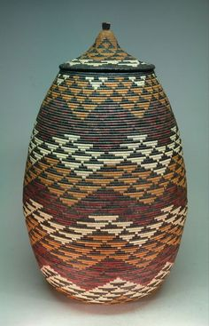 Woven basket by Phumelele Mhcongo, a master basket weaver from Kwa Zulu Natal.