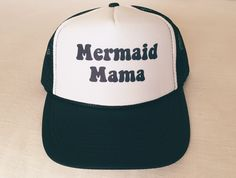 A personal favorite from my Etsy shop https://www.etsy.com/listing/252866979/mermaid-mama-trucker-hat