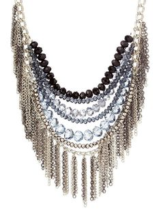 """Silver Beaded Fringe Necklace. Why do they call this style """"bib"""" necklace? Such an unattractive name for a really pretty (and heavy looking) pc of jewelry."""