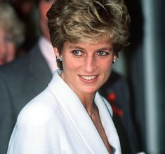 December 1, 1994 Princess Diana arrives at the Mortimer Market Centre, a service for HIV/AIDS sufferers in London