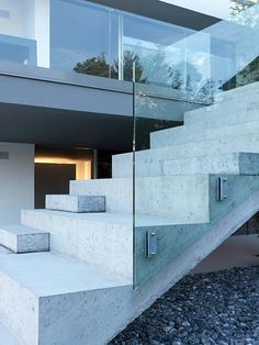 ...concrete stairs, glass balustrade