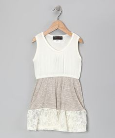 Delicate lace trim and a smart sleeveless cut give this playful piece the kind of charm that girls adore. Soft stretchy fabric construction means this piece is as much a delight to wear as it is to behold.