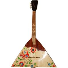 New Russian Balalaika 3 String Prima Wood. High Quality. New Russian / Ukrainian Balalaika 3 Three String Prima. Hand Painted! Wood! High Quality!. This is a musical instrument for orchestra, ensemble and solo players. It is also a good musical instrument for beginners. This balalaika is absolutely new. It was made in Ukraine. The instrument is made of of maple and white wood. Body canted with valuable species of timber. Pegs mechanics belongs to an open type. Characteristics: Strings: 3...