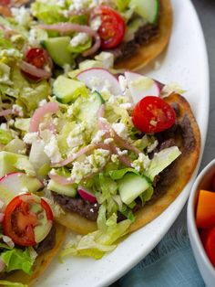 These easy vegetarian tostadas are topped with refried black beans, tons of veggies and a creamy cilantro sauce! A quick and easy weeknight meal.  #rachaelhartleynutrition #thejoyofeating #tostadasrecipes #tostadas #vegetarianmexicanrecipes #vegetarianrecipes #healthymexicanrecipes #blackbeantostada #glutenfreerecipes #glutenfree #gutenfreemexicanrecipes Veggie Meals, Veggie Recipes, Easy Recipes, Easy Weeknight Meals, Quick Easy Meals, Vegetarian Mexican Recipes, Healthy Foods, Healthy Recipes, Cilantro Sauce