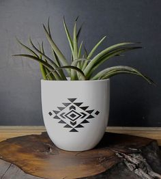 ADORE this Aztec print vase/container.  Simple enough for a sparse modern space, patterned enough for the knick-nack lovers.
