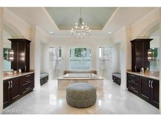 29055 Teramo Way, Naples, FL | Stunning master bathroom with walk through shower, square soaking tub, and dual vanities.  Golf estate home in the Teramo neighborhood of Mediterra