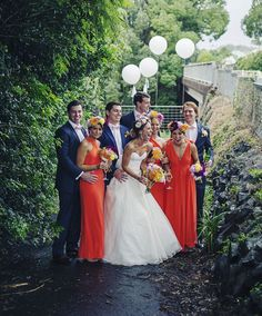 Emily and Matt's Bangalow wedding. I've walked over that bridge many, many times! Love the orange + pops of floral colour on the bridesmaids.