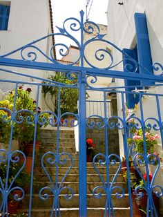 Mediterranean colors & blue wrought iron gate