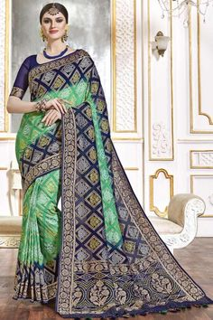 Green And Blue viscose saree with blue viscose blouse. Embellished with woven zari work. Saree with U Neck, Elbow Sleeve. It comes with unstitch blouse, it can be stitched to 32 to 58 sizes. #weddingsaree #weddingwearsaree #festivalwear #partywearsaree