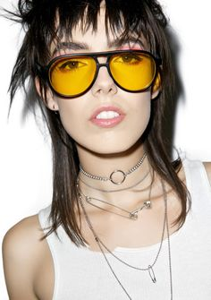 076d28eb41 These dope sunglasses feature a matte black aviator frame with yellow  tinted lenses.