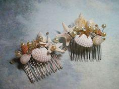Wedding Hair Comb Bridal Natural Seashell and Starfish Hair Comb Headpiece with Pearls Crystals for Beach Weddings. $42,00, via Etsy.