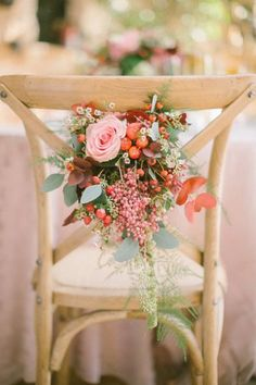 Winter wedding flowers decorate the table chairs: http://www.stylemepretty.com/little-black-book-blog/2014/12/22/boho-chic-winter-wedding-inspiration/ | Photography: Anna Roussos - http://www.annaroussos.com/:
