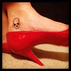 Pure Metal Mulisha Maiden. Skull tattoo and red heels.
