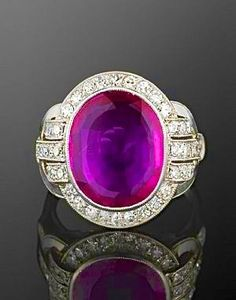 Art Deco ring: An oval Burma ruby surrounded by diamonds.