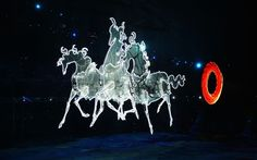 Sochi 2014 Winter Olympics opening ceremony - A chariot pulls a ring of fire