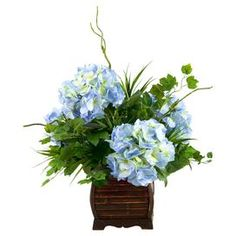 """Faux hydrangea arrangement in a rectangular bamboo planter. Made in the USA.  Product: Faux floral arrangementConstruction Material: Silk and bambooColor: Blue and greenFeatures:  Includes faux hydrangeasMade in the USAMaintenance free Dimensions: 27"""" H x 24"""" W x 24"""" D Cleaning and Care: Dust with dry cloth"""