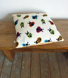 http://www.etsy.com/listing/91795642/ladybird-cosy-cushion