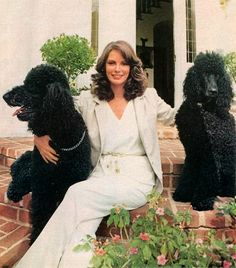 Jackie poses with her standard poodles.