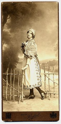 Girl In Moravian Folk Costume    She is dressed as a country girl but after the tights and the shoes is she from some bourgeois family. To wear the national folk costume was fashionable in czech patriotic families. Photograpic studio Rafael in Brno (Moravia, Czechia). Circa 1910.