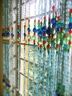 Kind of like this, make suncatcher that makes the room glow, use redd and oranges and yellows and ambers, thicker beads and more strands than this pic