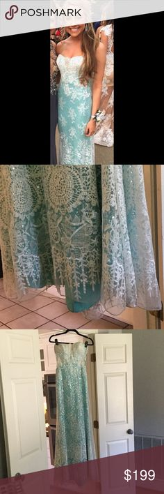Beautiful ICE BLUE and lace long formal Stunning ice blue and lace long formal gown.  This dress is a size 2 but would fit female of size 2-6.  The sweetheart neckline is gorgeous and there's elegant lace small see thru cut outs on sides if you raise your arm.  Worn for 2 hours.  Excellent condition from clean smoke free home. But selling for great price bc  I walked through dirt and back train lace trim got a little dusted with light dirt.  No one can see/notice - But I wanted to be honest…
