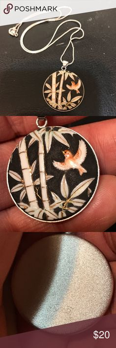 Asian porcelain & gold leaf necklace, silver chain Handcrafted..artist signature is carved on back..unfortunately I cannot read kanji so I can't give the artist credit where it is due. It's the size of a quarter..beautiful raw onyx looking rough feeling background. gorgeous artwork depicting a bamboo forest and a red Phoenix in flight..gold leaf on every edge and bamboo section. Sterling silver chain is 16in..new condition I've only worn it twice.i have another necklace that I refuse to take…
