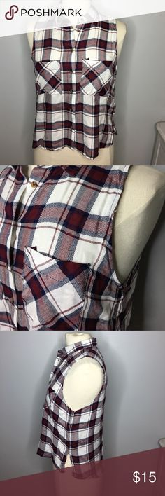 Polly & Esther Plaid Sleeveless Button Up Shirt Super Button Up Plaid Sleeveless Shirt by Polly & Esther from The Buckle. Features colors of navy, maroon and white. Brand new with tags - never worn. Size Small. Lightweight. Smoke free home. Polly & Esther Tops