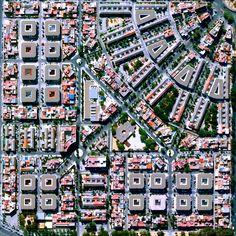 12/18/2014 Gran Plaza Seville, Spain 37.378882317°, -5.963216136°  Residential buildings surround the Gran Plaza in Seville, Spain.