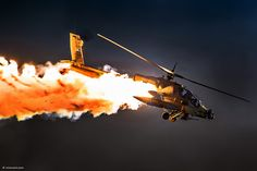 This photo of AH-64 Apache helicopter salvoing flares in the dark is one of the best of 2013