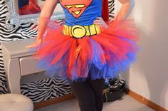 This sparkling tutu is made from a double layer of tulle in red and blue for a super full and poofy skirt! A stretchy elastic waistband