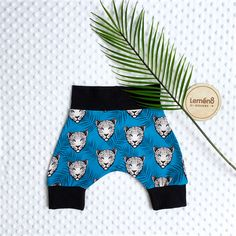 Trending Jungle theme shorties, cotton jersey harem shorts leopard and fern leaves