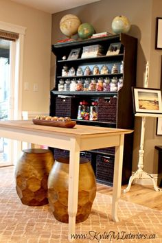 decorating and organizing ideas for kids craft and art supplies in a playroom or familyroom, slightly rustic style with globes for accessories - Kylie M Interiors