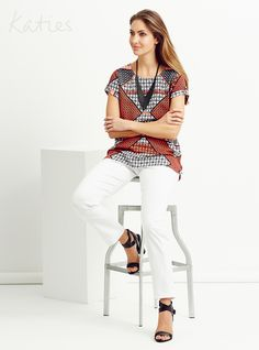 STATEMENT PRINTS / Make a simple yet smart statement in an exclusive graphic geo print. Black and soft white partner perfectly with vibrant red in a multi-tasking woven tee. Geo, White Jeans, Vibrant, Clothes For Women, Stylish, Simple, Classic, Prints, How To Make