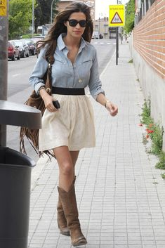 Any Oxford type button shirt with cool boots will work with a short flowy A-line skirt. Great idea!
