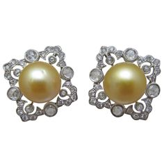 Gold Color Pearl Diamond Clip On Earrings   From a unique collection of vintage clip-on earrings at http://www.1stdibs.com/jewelry/earrings/clip-on-earrings/