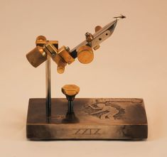 My custom fly vises are functional art made from a variety of wood and metal. Each handmade vise is one of a kind. Fly Tying Vises, Fly Tying Tools, Fly Fishing Gear, Jewelry Tools, Wood And Metal, Simple Designs, Handmade, Benches, Miniature