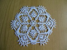 Apricot round crochet cotton white doilies Mercerised cotton size 21 cm It will be pretty on your furniture Its round shape makes it easy to place Easy care machine washable A VERY NICE GIFT