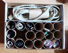 shoe box and toilet paper rolls to hold your cords and cables