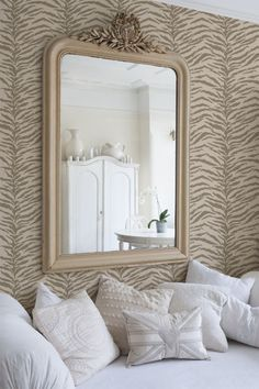 Wall Stencil | Tiger Stripes Pattern Stencil | Royal Design Studio. I'm assuming by the mirror reflection that this is an accent wall. Great idea for this pattern.