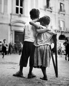 Boy Helps Amputee Friend Injured in War in Naples, Italy by  Henri Cartier Bresson 1944
