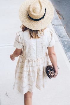 white eyelet lace dress, panama hat, prosecco and plaid