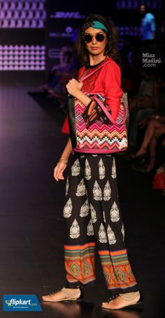 'Global Desi's a/w '13 showcase presented influences from tribal and gypsies, that were interestingly fused to form a look that is cool and free spirited. Printed palazzos teamed with embroidered kurti tops can form the base for a fun look. A cool desi-graphic tote, a printed bandana and a pair of shades would add that sense of 'street chic'. #missmalini