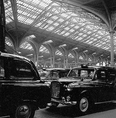 Liverpool Street Station, London, 1960. Beautiful Victorian vaulted ceiling and beautiful old taxis.