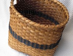 Storage Basket Handwoven with wooden base in blue. $35.00, via Etsy.